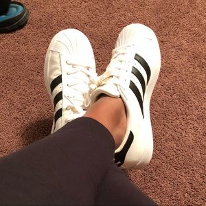 Adidas tennis with black stripes